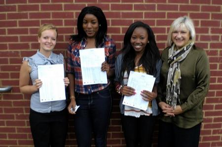 Students at Dartford Technology College celebrate GCSE results with head teacher Trish Burleigh