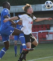 Welling's Anthony Acheampong challenges Dover's George Purcell