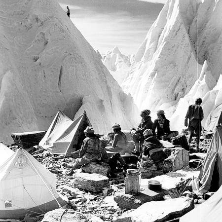 Porters enjoying the sunshine at Camp II on the East Rongbuk Glacier by Hugh Ruttledge, 1936