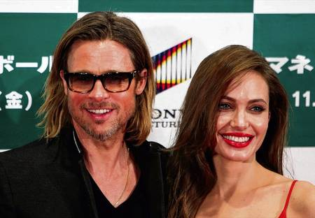 Brad Pitt and Angelina Jolie Picture: AP Photo/Lee Jin-man/PA Photos