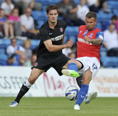 Gills striker Adam Birchall battles for the ball