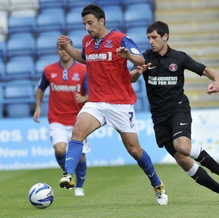 Gillingham midfielder Chris Whelpdale keeps ball