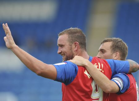 Danny Kedwell takes congratulations from Charlie Lee for scoring Saturdays winner