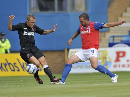 Gills striker Danny Kedwell goes for the ball