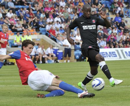 Gills new defender Tom Flanagan challenges Bradley Wright-Phillips for the ball