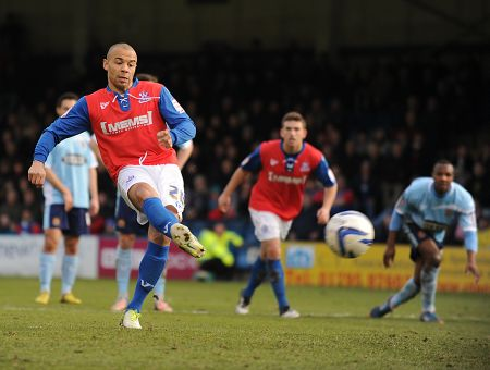 Deon Burton tucks away the penalty after Anton Robinson is fouled in the box