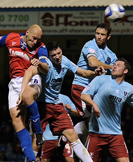 Adam Barrett wins this aerial battle