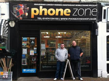 Phone engineer Darren Corcoran and shop owner Daniel Bennet outside Phonezone where the images were discovered