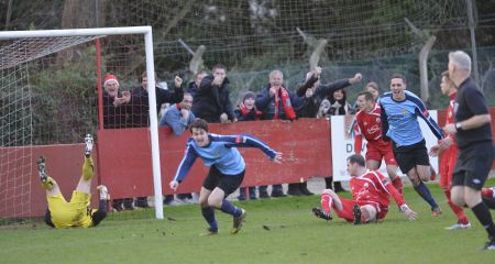 Sittingbourne's Tom Loynes scores against Hythe