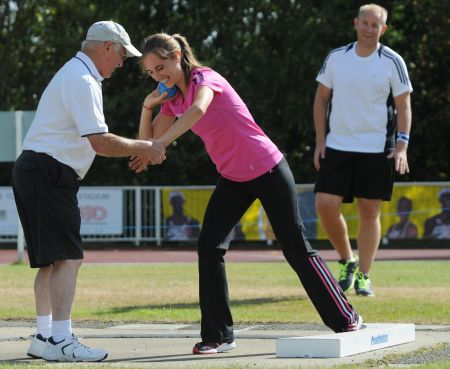 Lisa Dobriskey tries shot put as part of Inspire Kent - coached by Ashford ACs Ted Hawkins