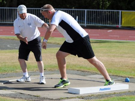 Coach Ted Hawkins gives Alex Hoad shot put guidance