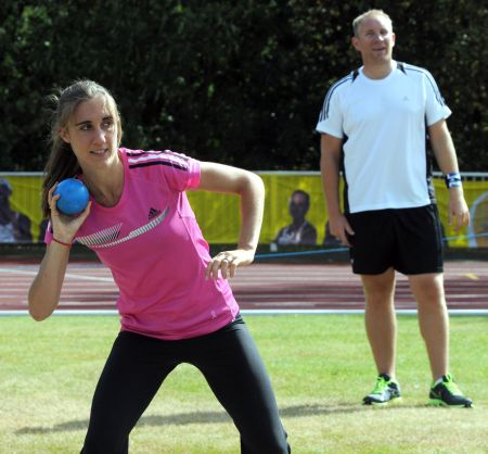 Lisa Dobriskey taking part in the shot put with Alex Hoad looking on