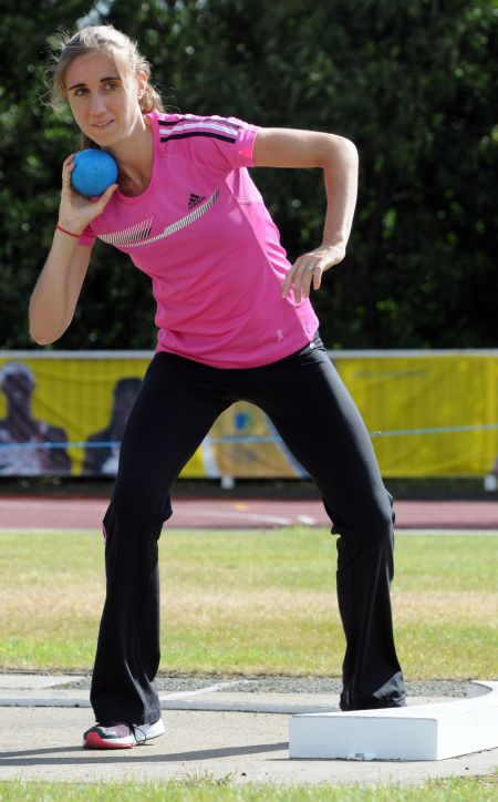 Lisa Dobriskey tries the shot put as part of Inspire Kent