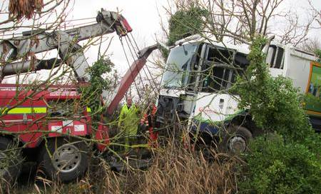Dustcart overturns in ditch