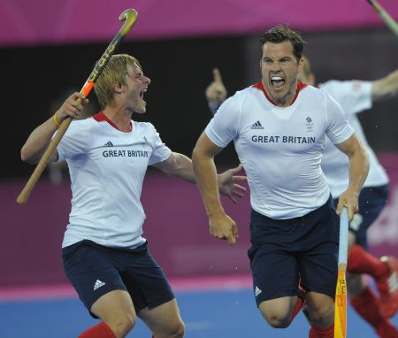 Ashley Jackson (left) celebrates a goal in the Mens Team GB match against Australia