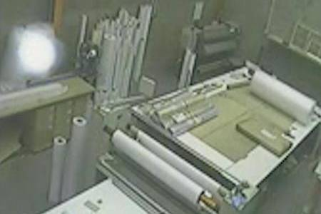 CCTV images show a mysterious white orb floating across the camera at printing company SMP Large Format