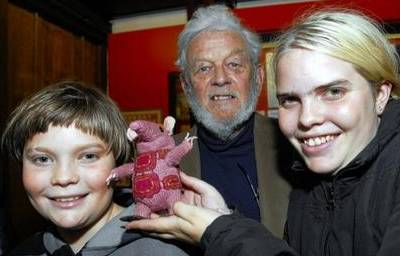 Museum of Canterbury 40th Birthday of the Clangers. Creator Peter Firmin centre with Michael Woodrow, with his sister Laura and one of the Clangers.