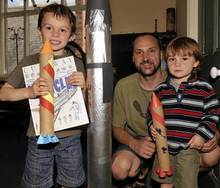Five-year-old Edward (left), three-year-old James and dad Damon Wiffen, from Sturry, at the moonlanding exhibition at the Museum of Canterbury