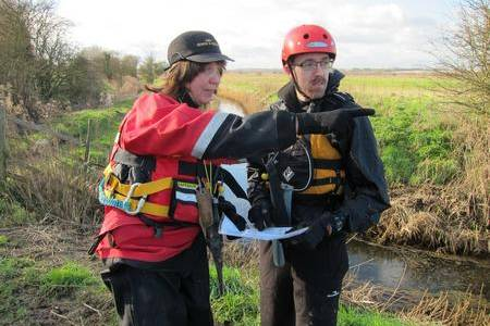 Kent Search and Rescue volunteers Darren Wimsett and Jo Kenny survey the Stodmarsh nature reserve.