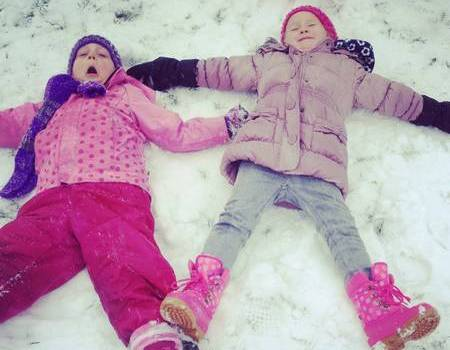Isla Healy, four, and Izzy Hunt, also four, from Iwade, making snow angels.