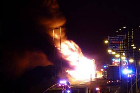 Flames lick the skyline after a lorry caught fire on the M20