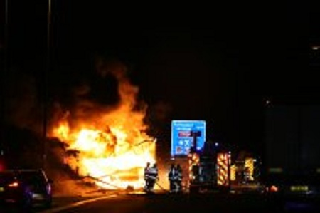 Firefighters battle the lorry blaze on the M20. Picture: Stewart Johnson