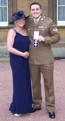 Mark Carpenter with his wife Amy at Buckingham Palace