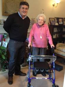 Daniel Ball, of First Choice Mobility, with Freda McGregor and her new walking frame