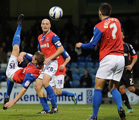 Callum Davies tries the spectacular as Gills look for a way to goal
