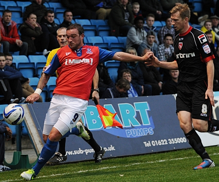 Danny Kedwell about to cross as Andrew Wright closes in