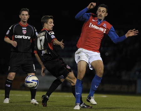 Chris Whelpdale tries to get the better of Andy Fleming