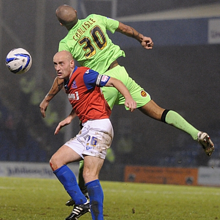 Adam Barrett takes on Clarke Carlisle