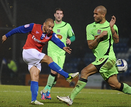 With a win needed to go top of League 2, Deon Burton goes for goal as Clarke Carlisle attempts to block
