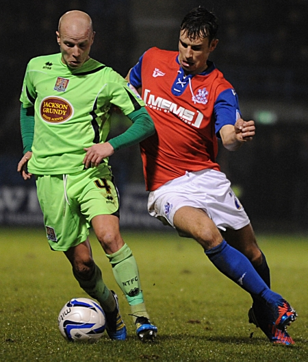Steven Gregory stays tight to Luke Guttridge