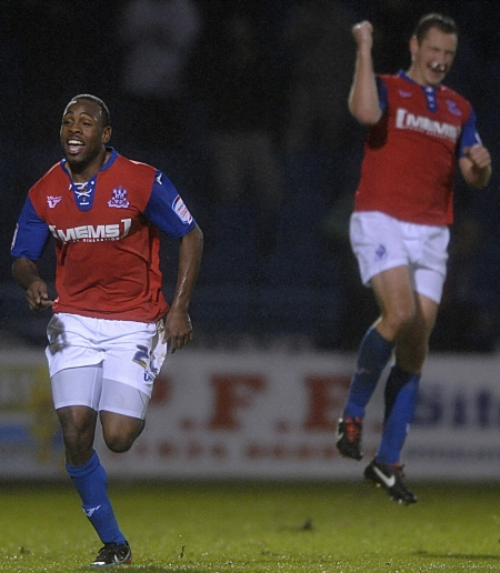 Myles Weston enjoys the moment after putting Gills 2-0 ahead with six minutes left