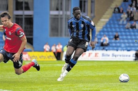 Gillingham's Mark McCammon in action against Shrewsbury