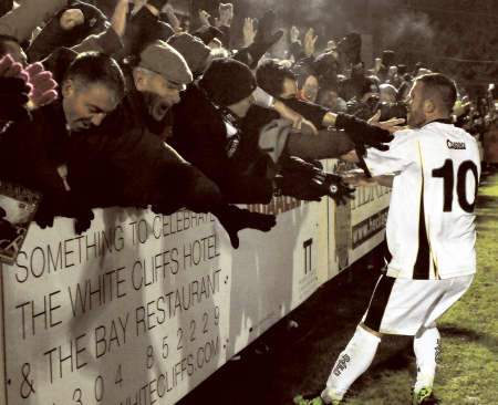 Adam Birchall celebrates his first goal against Aldershot with the Dover fans