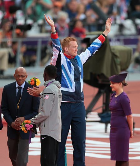 Greg Rutherford on the podium after winning gold for Team GB in the long jump