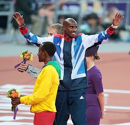 Team GBs Mo Farah celebrates winning the Olympic 10000m gold