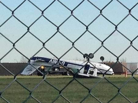 A plan left upside down after a crash at Rochester Airport