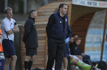 Martin Allen and John Schofield look on as the Gills battle for a point at Plymouth