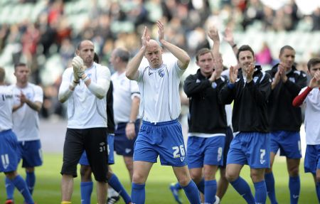 Gillingham captain Adam Barrett leads the players off after their warm-up at Plymouth