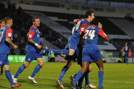 Gillingham celebrate their second equaliser of the day at Plymouth