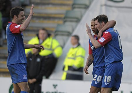 Ben Strevens is congratulated by Deon Burton and Chris Whelpdale after scoring Gillinghams first goal at Plymouth