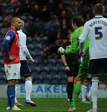 ...but is denied by a post as Preston keeper Thorsten Stuckmann celebrates