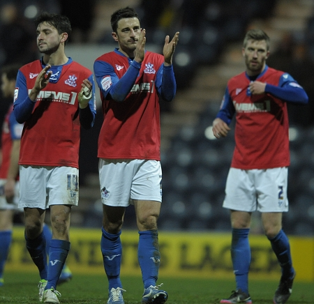 The Gills players thank the travelling fans for their support at the final whistle
