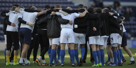 The Gillingham players in a pre-match huddle