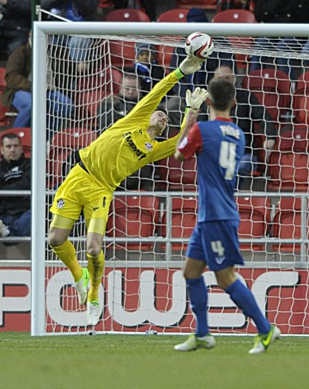 Goalkeeper Stuart Nelson makes a save
