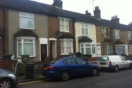 Police cordon off a house in Church Road after a shooting