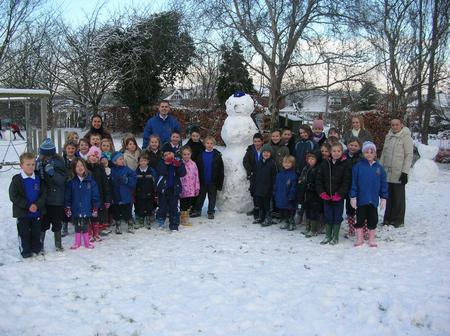 The children of West Malling CEP School with their snowman on Thursday. It was one of the few schools open. Picture courtesy head teacher Darren Webb